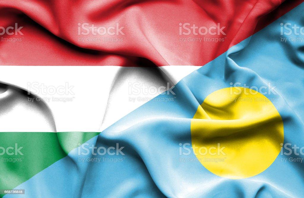Waving flag of Palau and Hungary stock photo