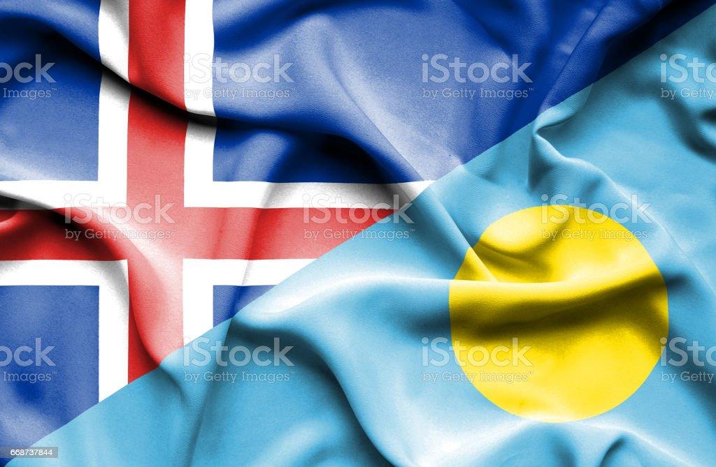 Waving flag of Palau and Iceland stock photo