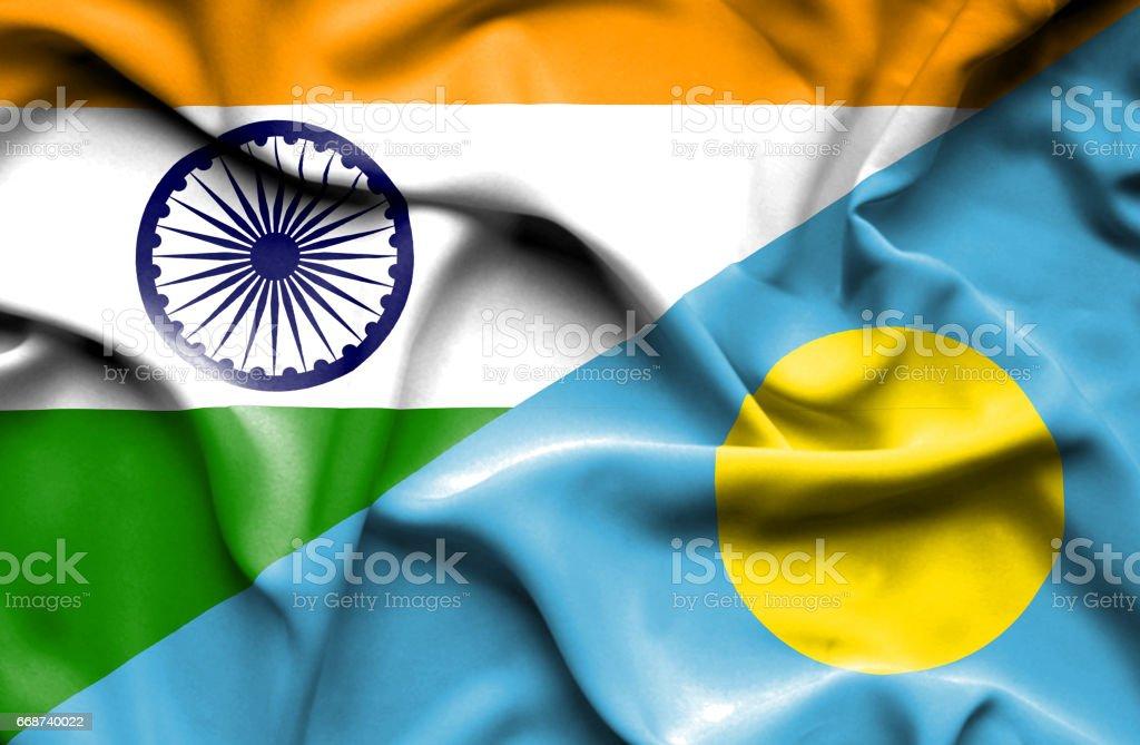 Waving flag of Palau and India stock photo