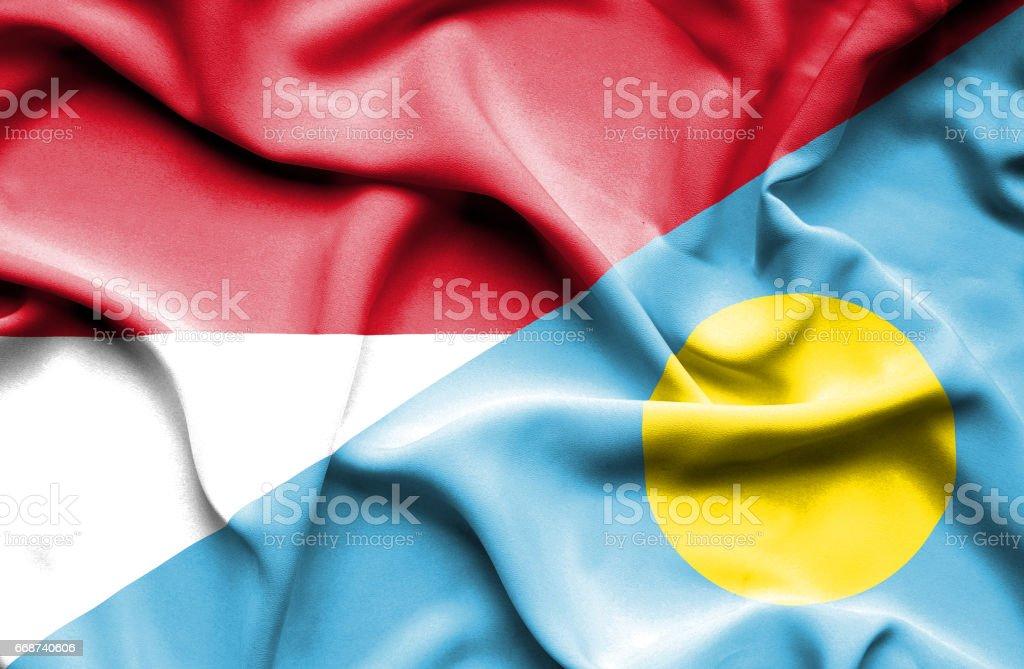 Waving flag of Palau and Indonesia stock photo