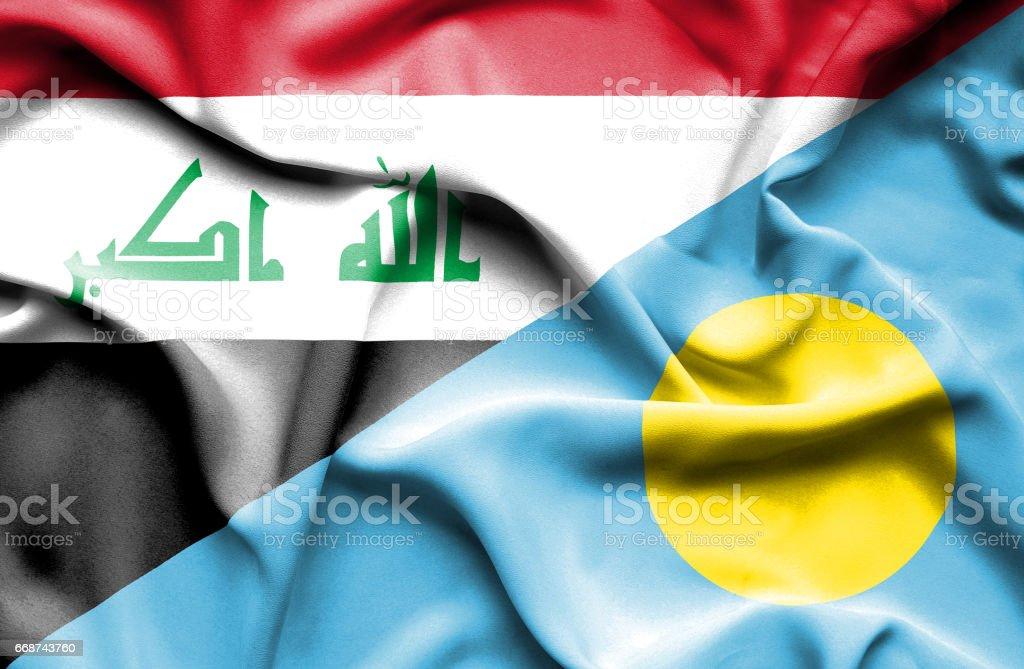 Waving flag of Palau and Iraq stock photo