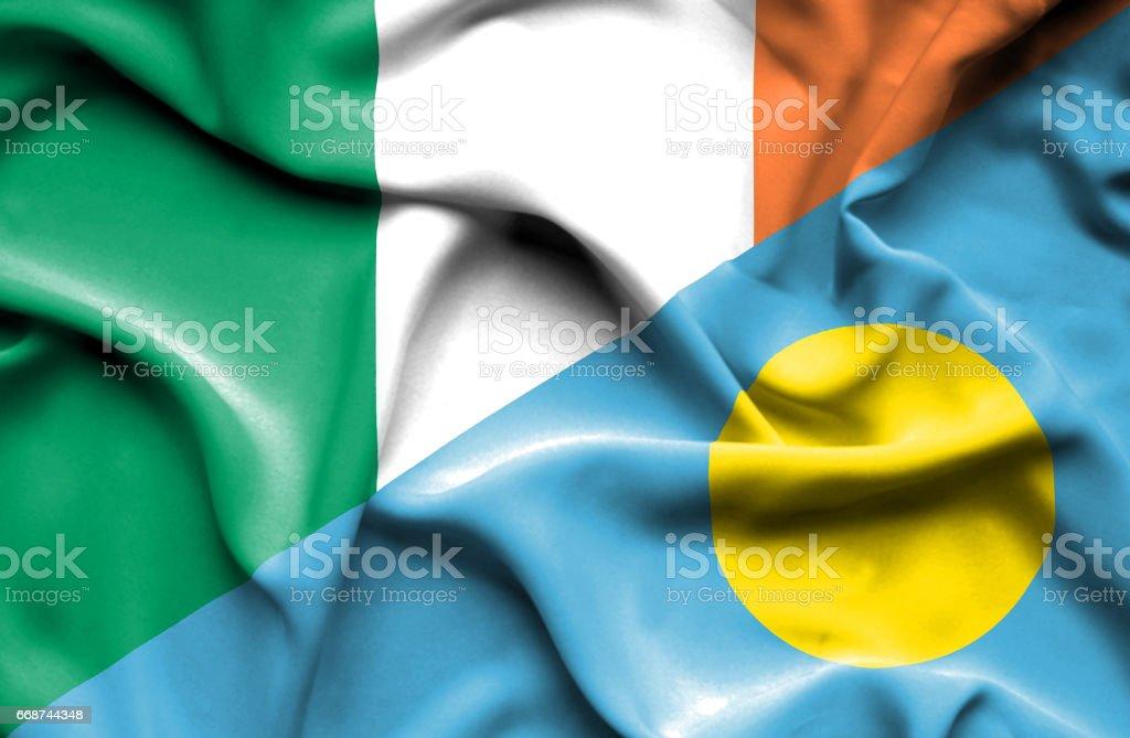 Waving flag of Palau and Ireland stock photo