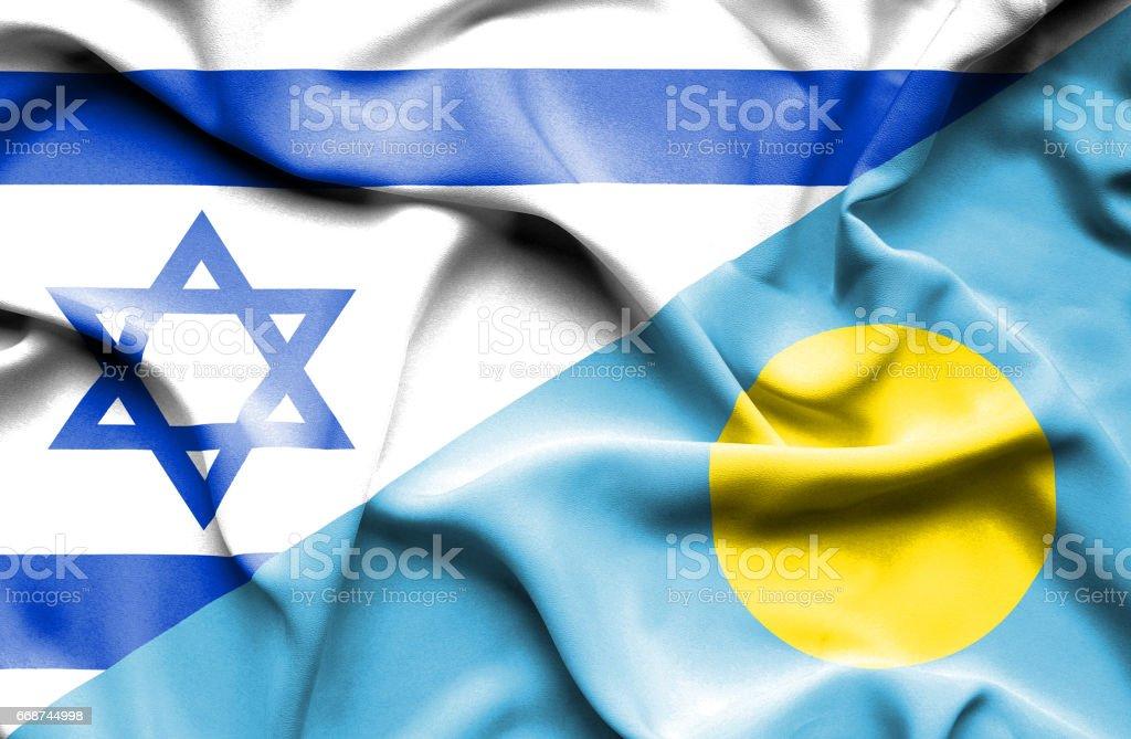 Waving flag of Palau and Israel stock photo