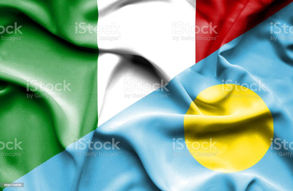 Waving flag of Palau and Italy stock photo