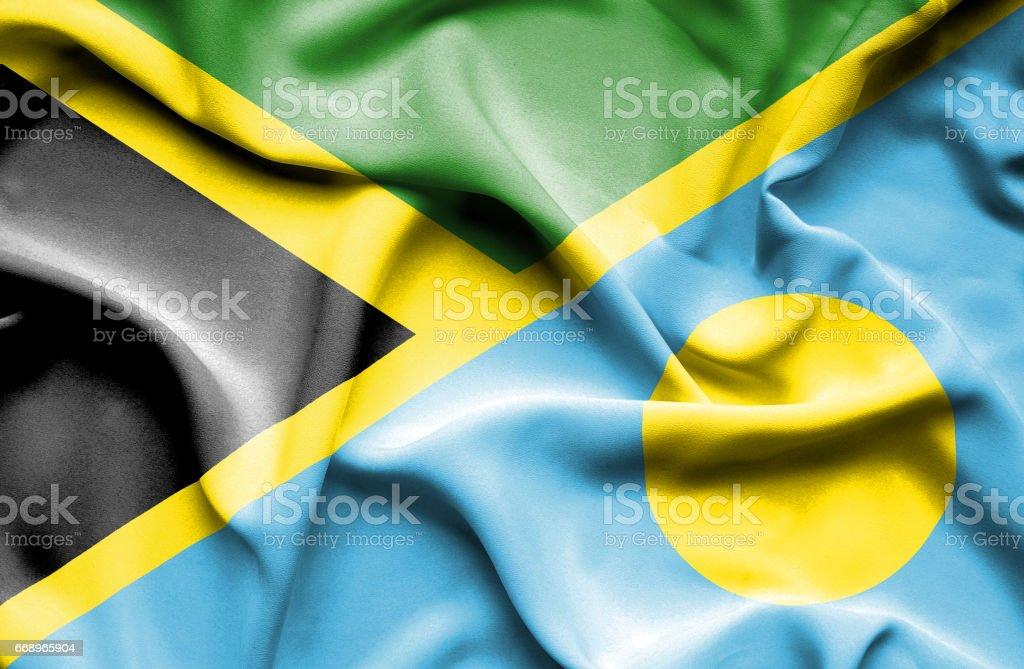 Waving flag of Palau and Jamaica stock photo