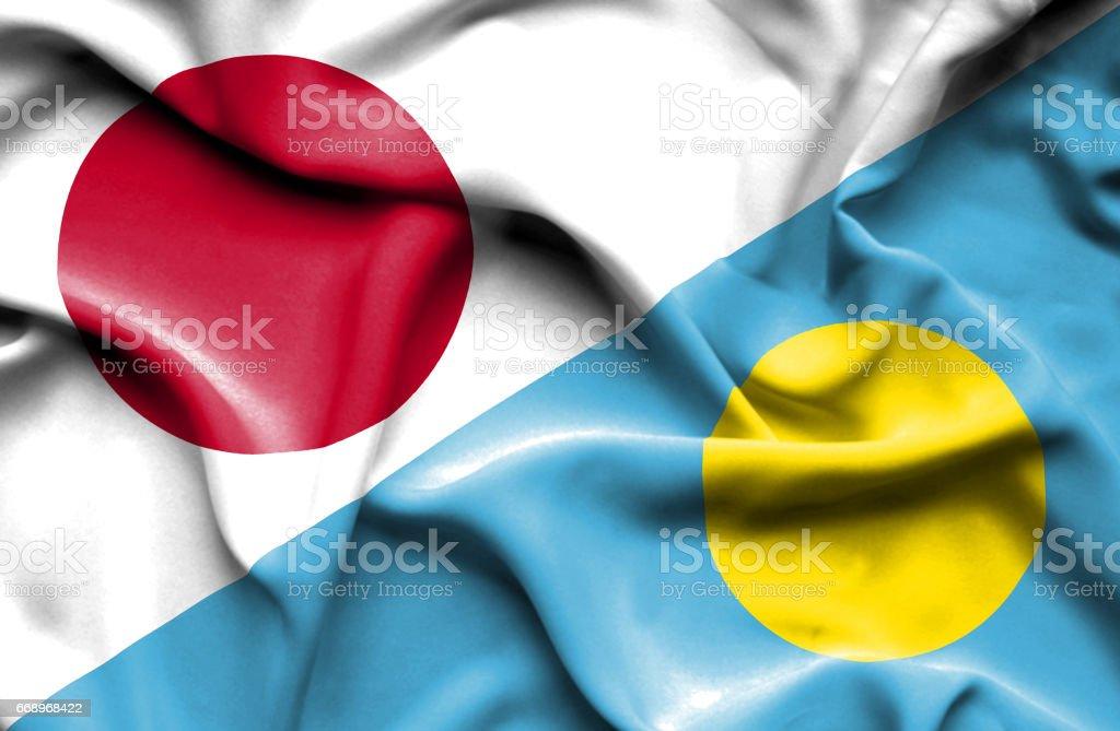 Waving flag of Palau and Japan stock photo