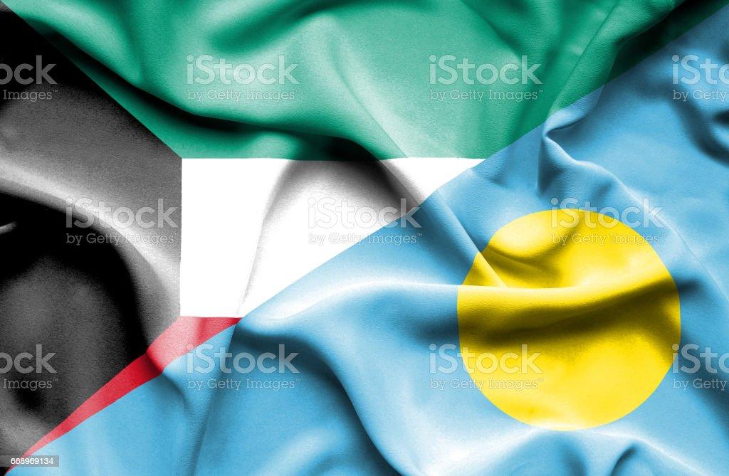 Waving flag of Palau and Kuwait stock photo