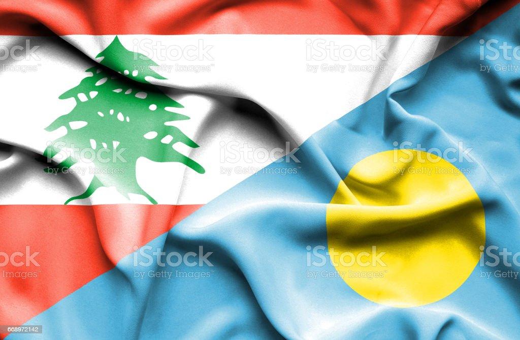 Waving flag of Palau and Lebanon stock photo