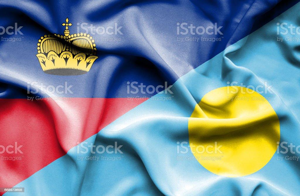 Waving flag of Palau and Lichtenstein stock photo