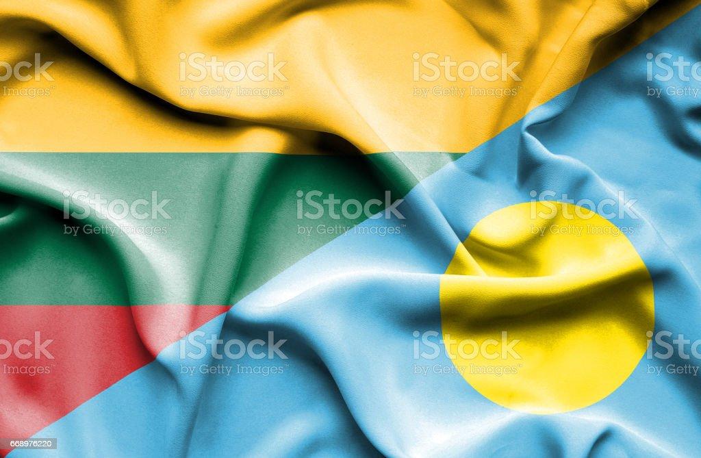 Waving flag of Palau and Lithuania stock photo