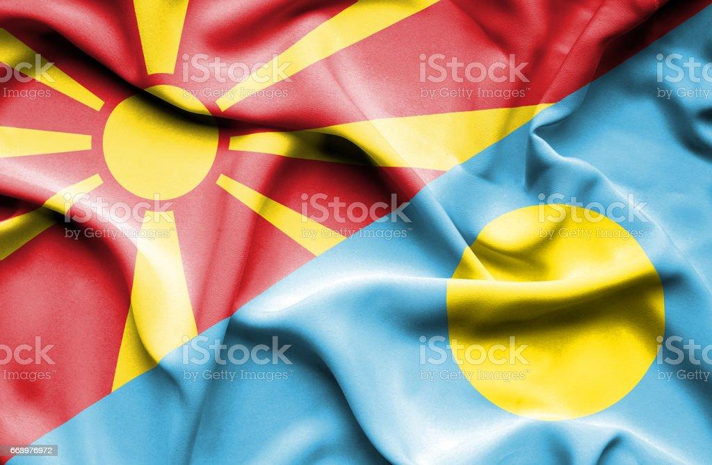 Waving flag of Palau and Macedonia stock photo