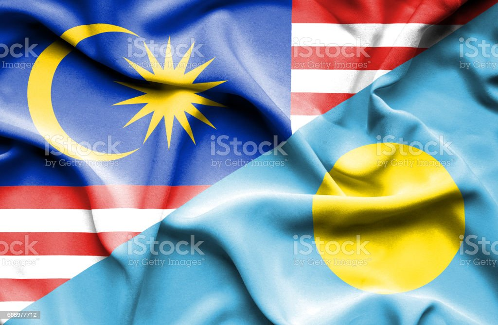 Waving flag of Palau and Malaysia stock photo