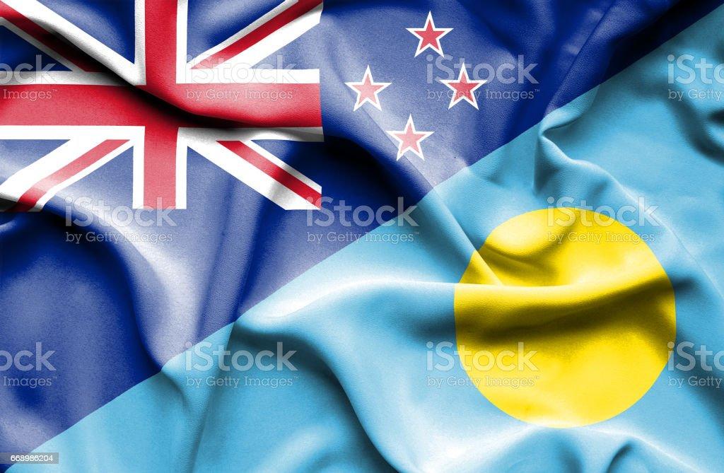 Waving flag of Palau and New Zealand stock photo