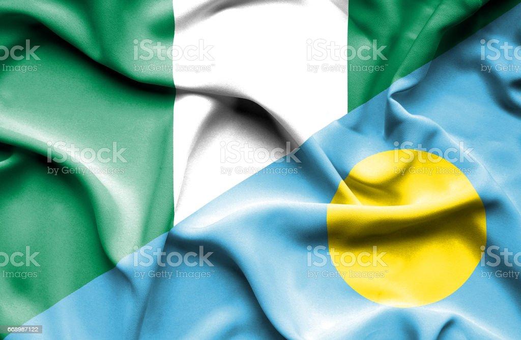 Waving flag of Palau and Nigeria stock photo