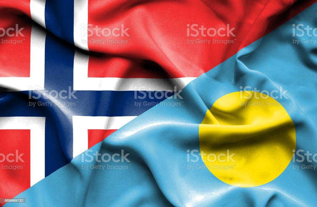 Waving flag of Palau and Norway stock photo
