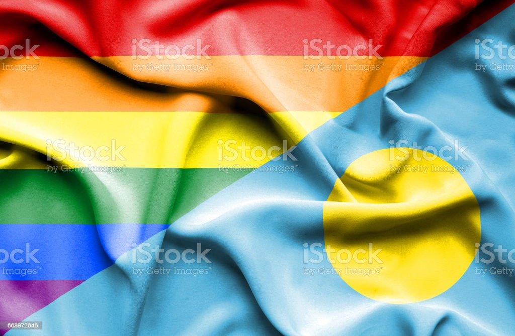 Waving flag of Palau and Pride stock photo