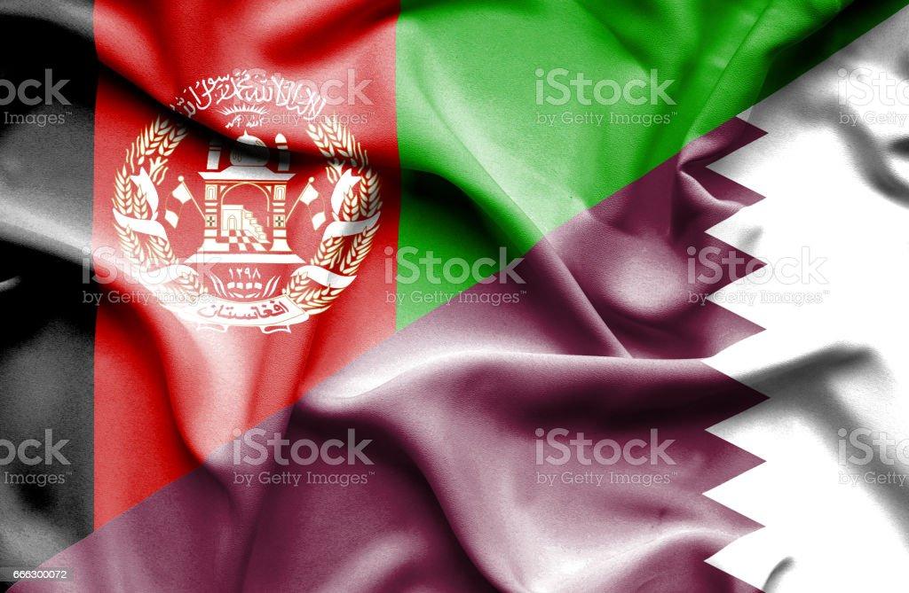Waving flag of Qatar and Afghanistan stock photo