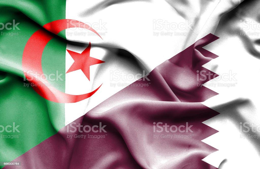 Waving flag of Qatar and Algeria stock photo
