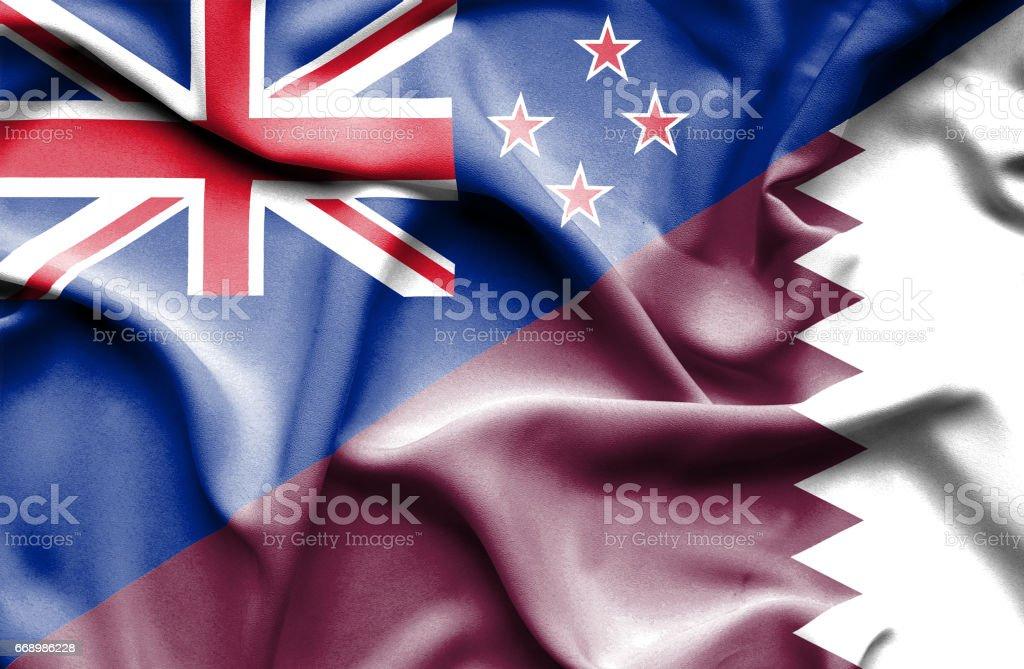 Waving flag of Qatar and New Zealand stock photo