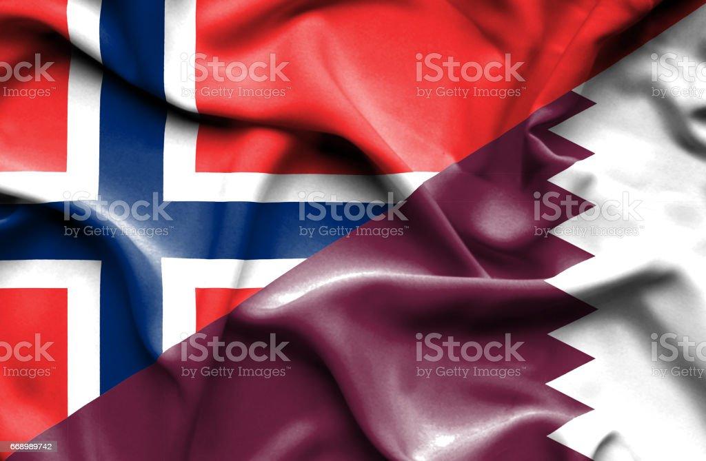 Waving flag of Qatar and Norway stock photo