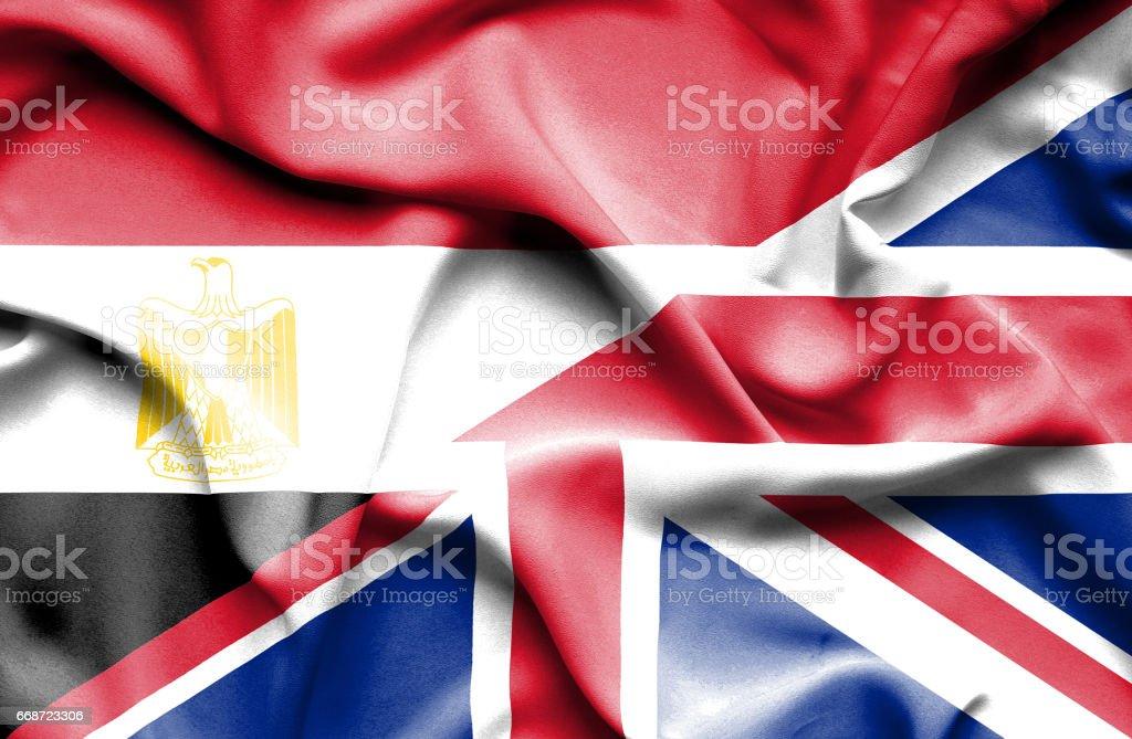 Waving flag of United Kingdon and Egypt stock photo