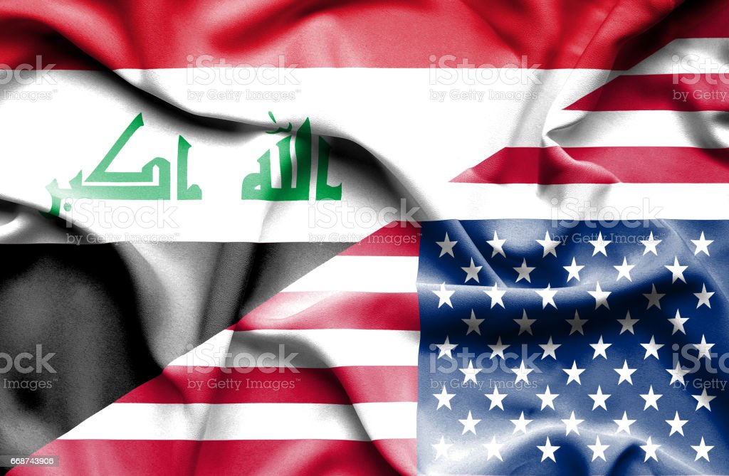 Waving flag of United States of America and Iraq stock photo