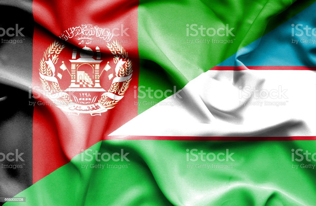 Waving flag of Uzbekistan and Afghanistan stock photo