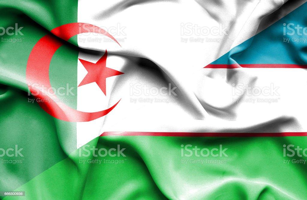 Waving flag of Uzbekistan and Algeria stock photo