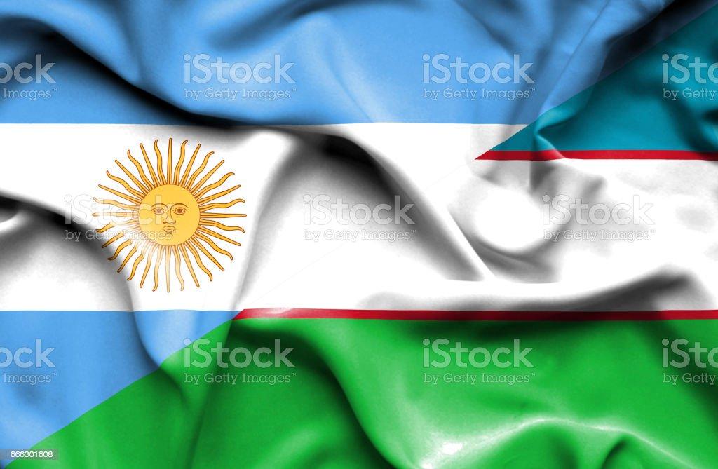 Waving flag of Uzbekistan and Argentina stock photo