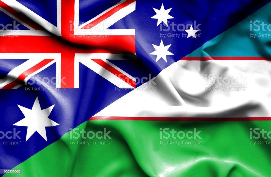Waving flag of Uzbekistan and Australia stock photo