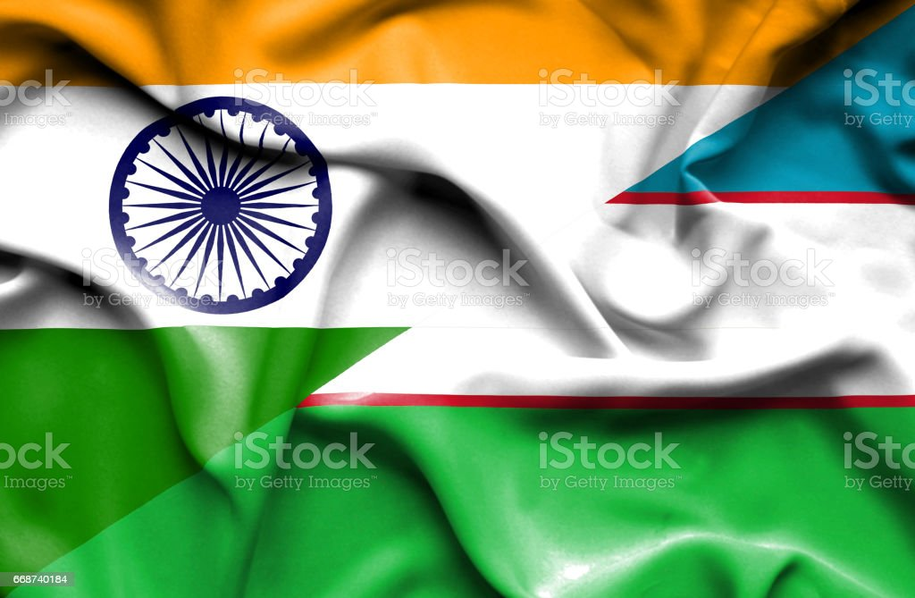 Waving flag of Uzbekistan and India stock photo