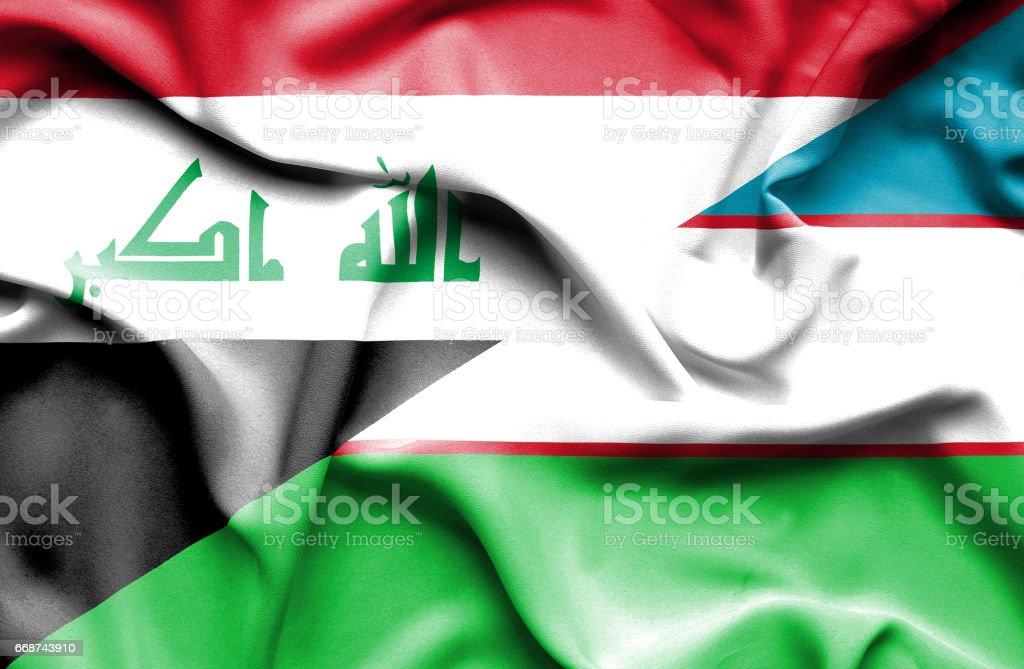 Waving flag of Uzbekistan and Iraq stock photo