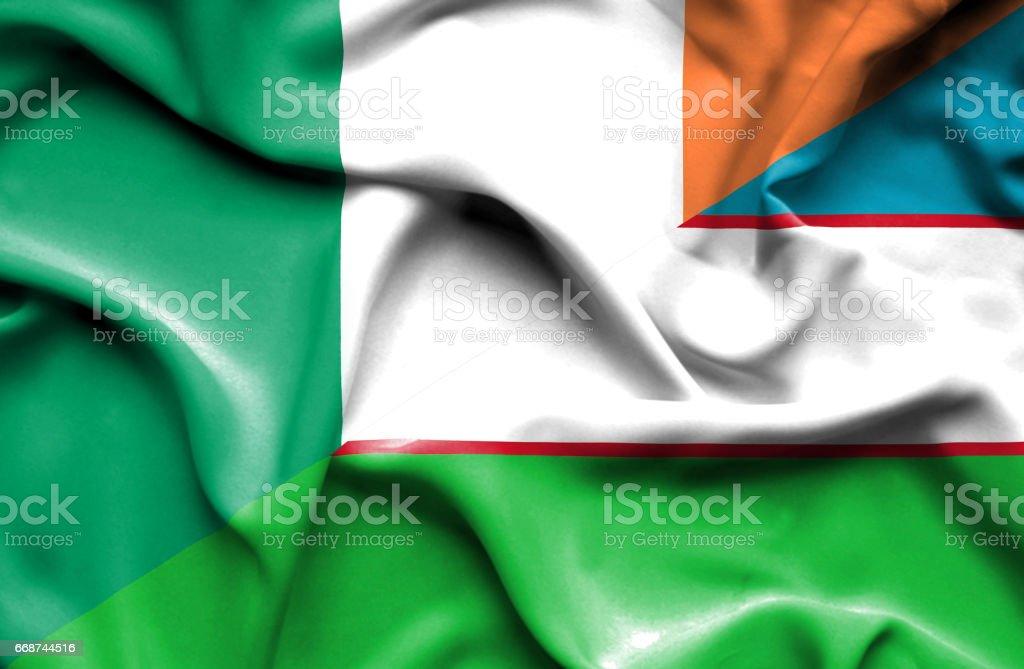 Waving flag of Uzbekistan and Ireland stock photo