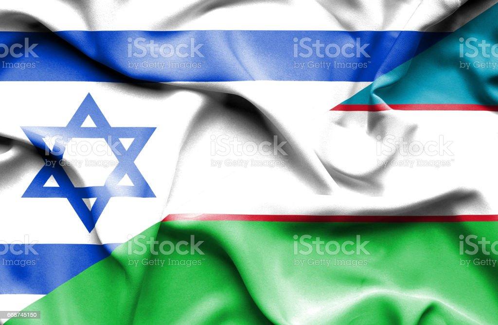 Waving flag of Uzbekistan and Israel stock photo