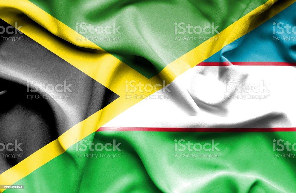 Waving flag of Uzbekistan and Jamaica stock photo