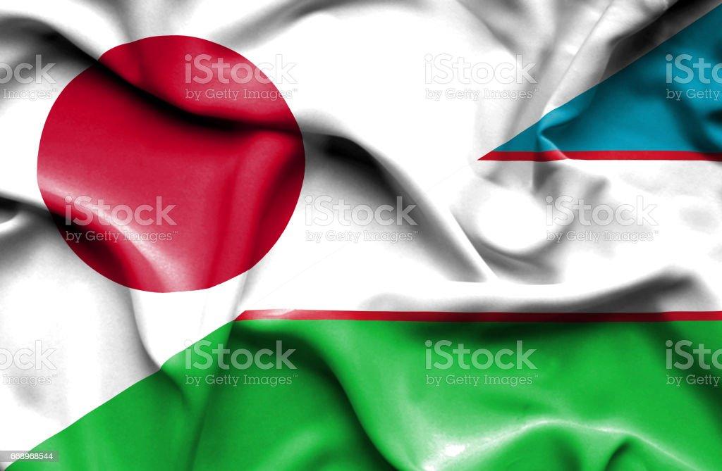 Waving flag of Uzbekistan and Japan stock photo