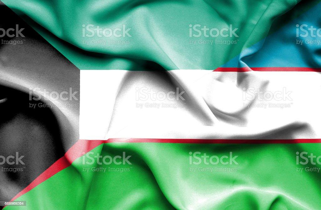 Waving flag of Uzbekistan and Kuwait stock photo