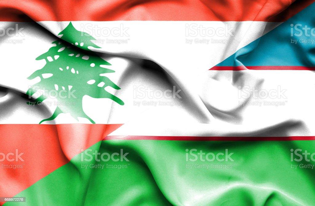 Waving flag of Uzbekistan and  Lebanon stock photo