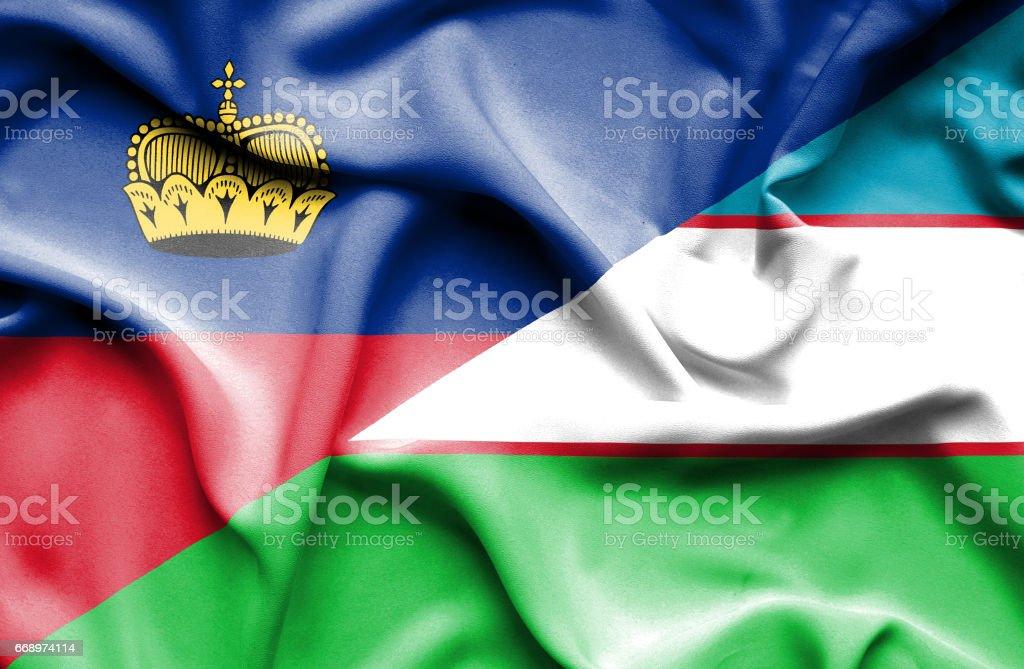 Waving flag of Uzbekistan and Lichtenstein stock photo