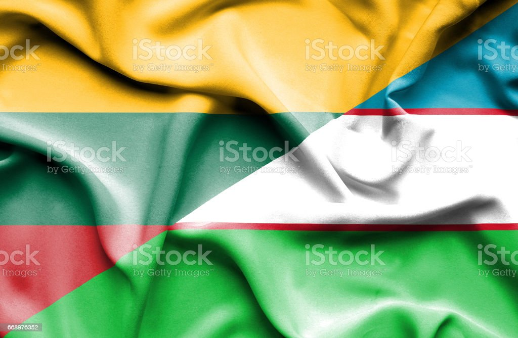 Waving flag of Uzbekistan and Lithuania stock photo
