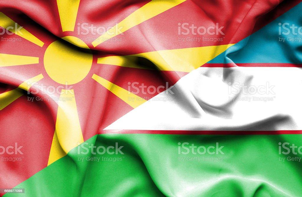 Waving flag of Uzbekistan and Macedonia stock photo