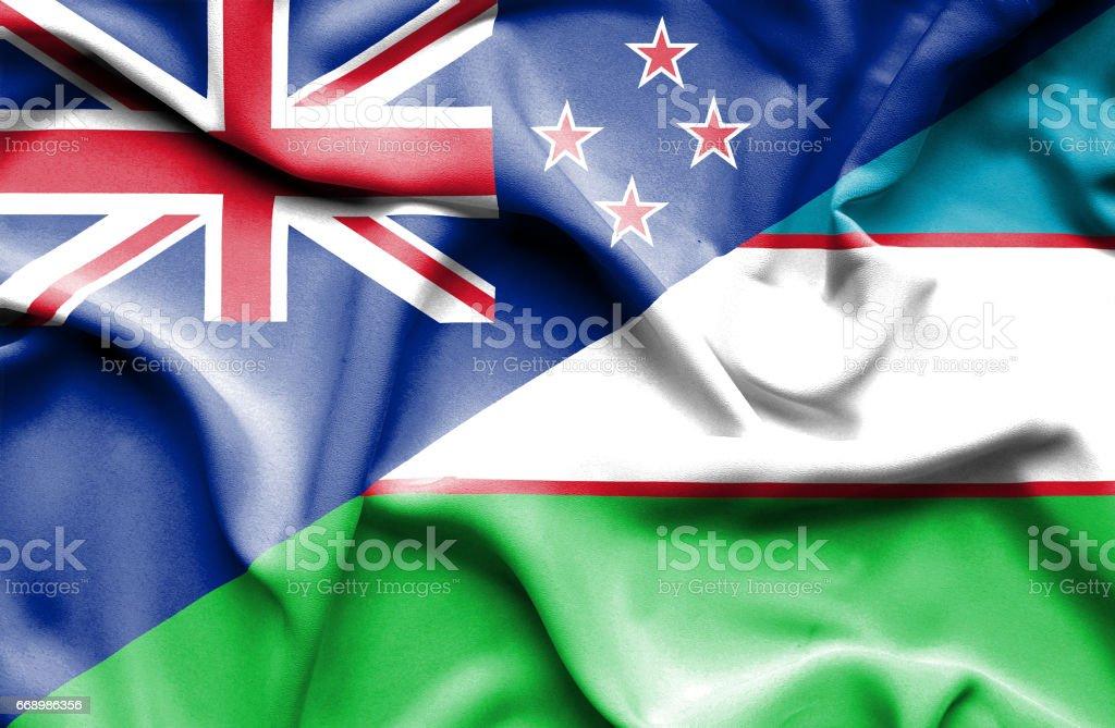 Waving flag of Uzbekistan and New Zealand stock photo