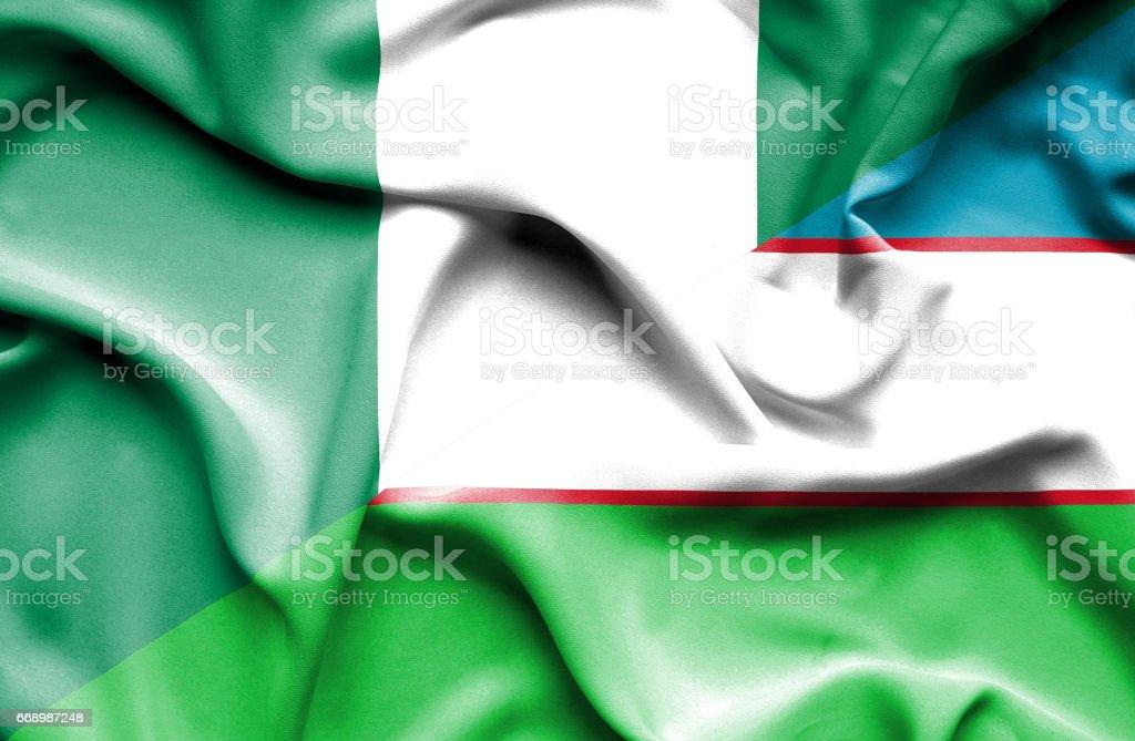 Waving flag of Uzbekistan and Nigeria stock photo