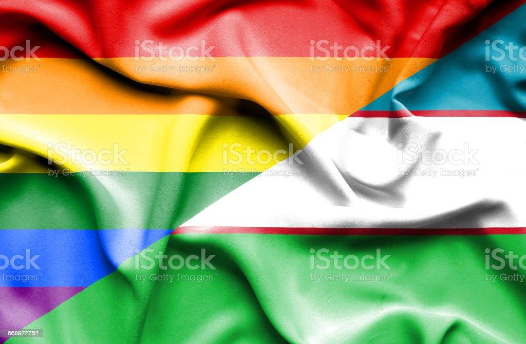Waving flag of Uzbekistan and Pride stock photo