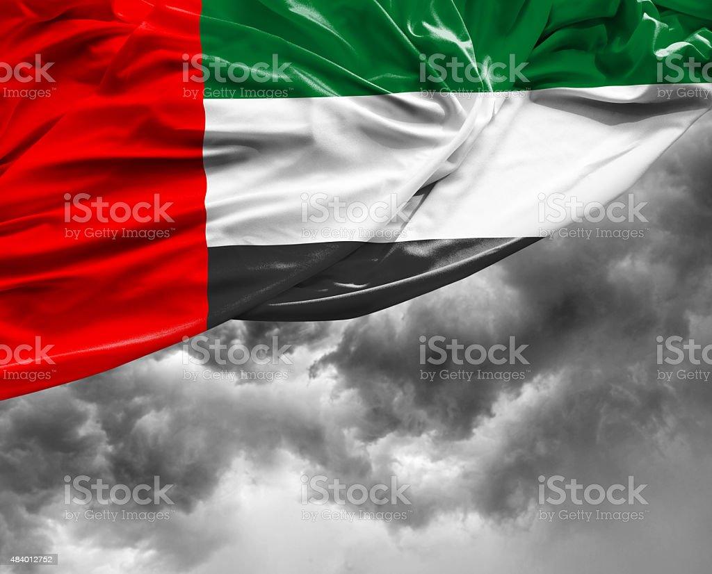 UAE waving flag on bad day stock photo