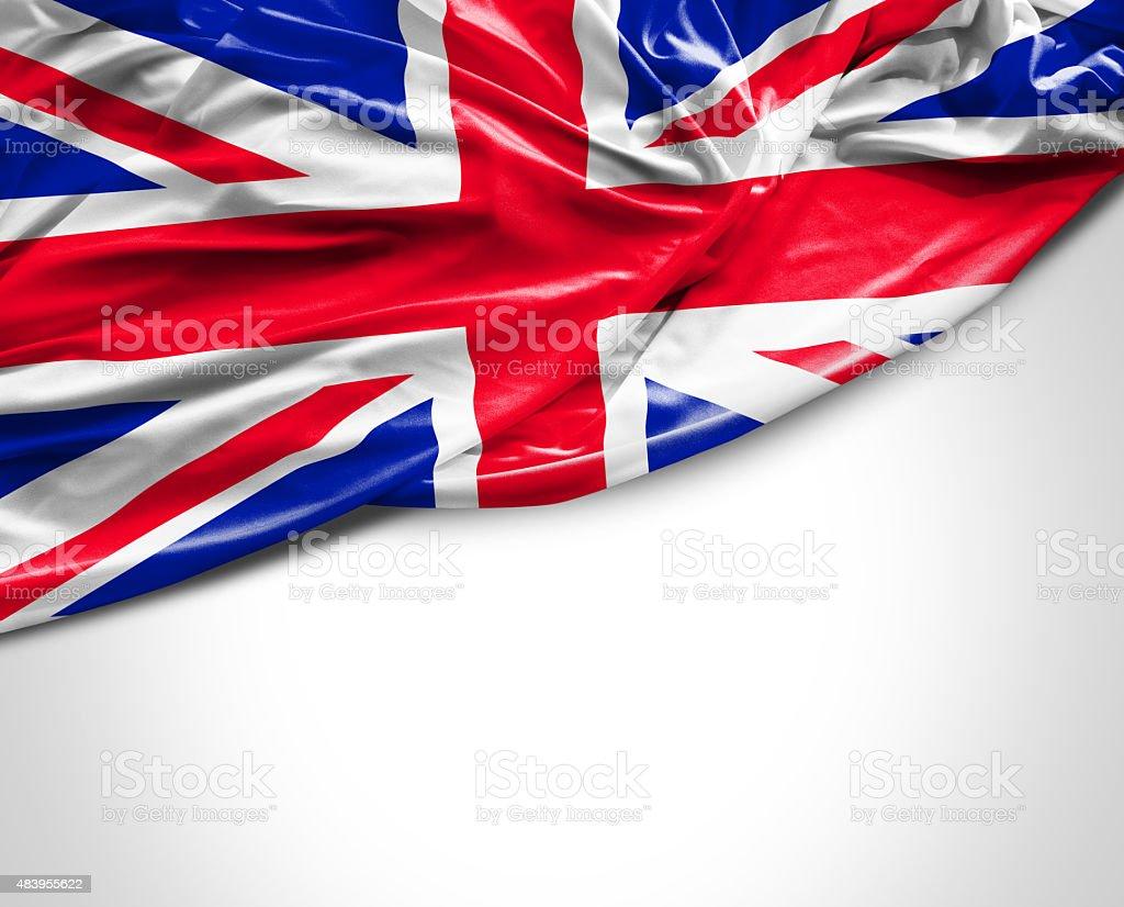 UK waving flag on white background stock photo