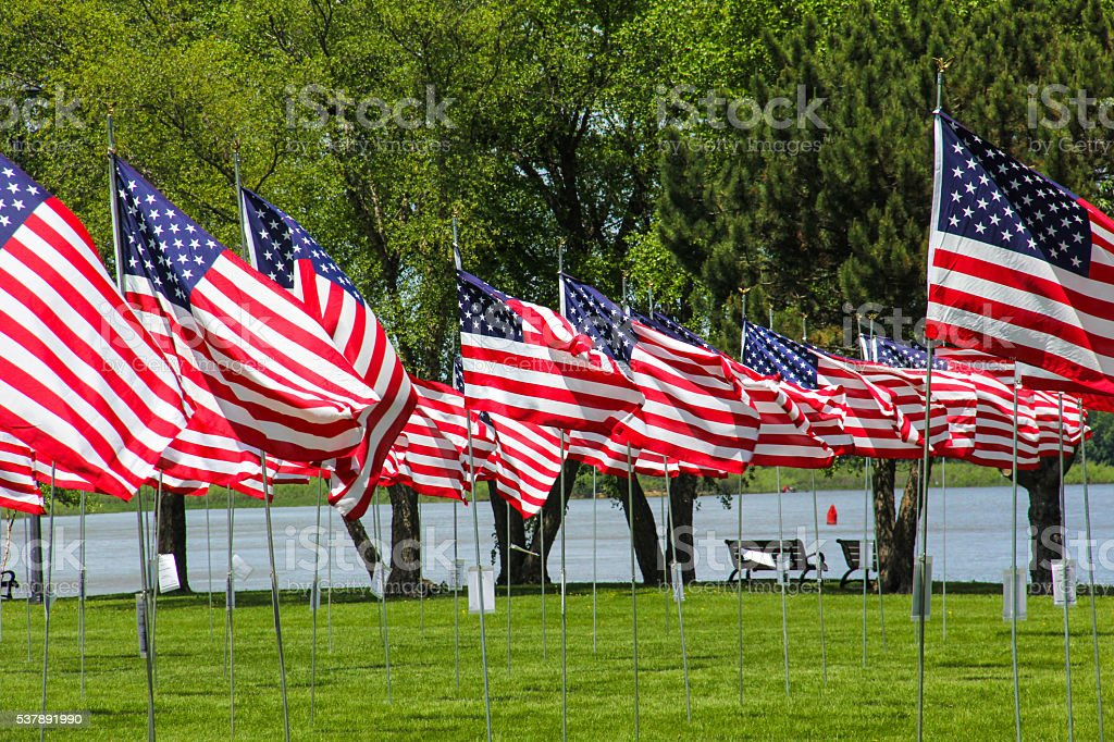 Waving Flags by the River stock photo