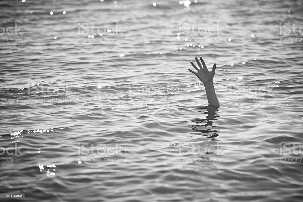 waving for help stock photo