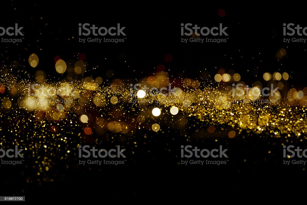 waving golden glitter stock photo