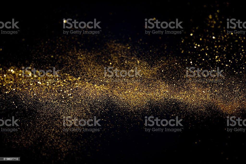 waving golden glitter stock photo
